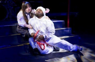 Emma Cambridge as Alice and Devon Kay as the White Rabbit in Chickenshed's 'Alice on the Underground'. Photo courtesy Chickenshed
