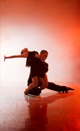 Nancy Nerantzi (here wearing black) and Liam Riddick in 'Burning'.  Photo © Chris Nash