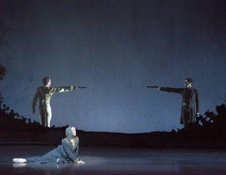"""Boston Ballet's Ashley Ellis, Patrick Yocum and Lasha Khozashvili in John Cranko's """"Onegin"""" Photo by Gene Schiavone"""