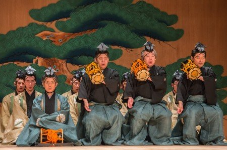 "Yasutaro Yamamoto (in blue) and Shoulder drummers, (L to R) Masayoshi Ko, Seiichi Iida, Yukihiko Yokoyama in a scene from Kanze Noh Theatre's production of ""Okina"" Photo Stephanie Berger"