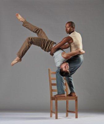 """Joseph Blake and Fausto Rivera of Chamber Dance Company in Zvi Gotheiner's """"Chairs"""". Photo Steve Korn."""
