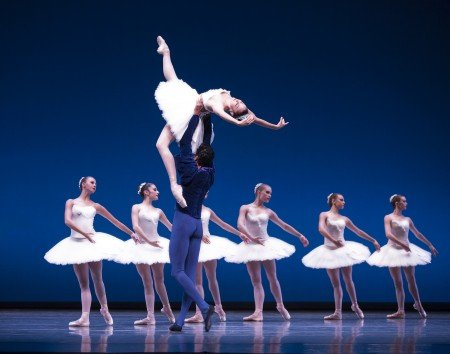 "Pacific Northwest Ballet dancers Laura Tisserand and Karel Cruz with company dancers in George Balanchine's ""Symphony in C"" Photo Angela Sterling."