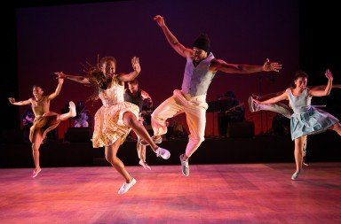 "Dormeshia Sumbry-Edwards and Derick K. Grant (foreground)  and Dorrance Dance dancers  in ""The Blues Project"" by Michelle Dorrance      Photo Christopher Duggan"