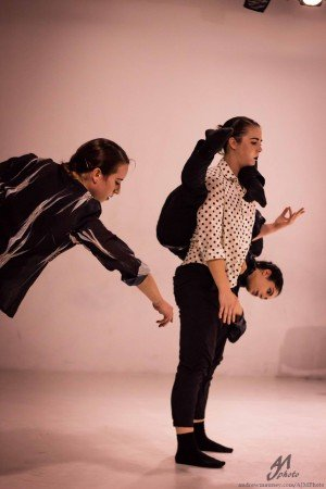 """Inclined Dance Project dancers (l-r) Shannon McGee, Elisabeth Wolf, and Maria Gardner (carried) in Kisten Klein's """"Turf"""" Photo Andrew J. Mauney"""