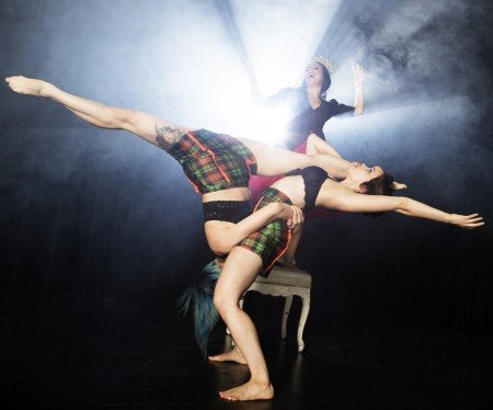 "KineticArchitecture Dance Theatre dancers (foreground) Meghann Bronson-Davidson and Brittany Posas (leaning back) in ""Wonder/Through the Looking Glass Houses"" Photo Peter Yesley"