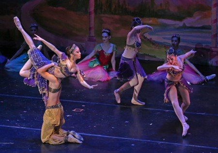 "Nanako Yamamoto (foreground) and American Repertory Ballet dancers in ""The Nutcracker"" Photo by Leighton Chen"
