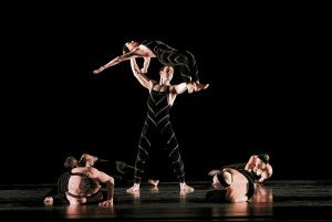 "Robert Kleinendorst and Paul Taylor Dance Company members in ""Promethean Fire"" Photo by Paul B. Goode"