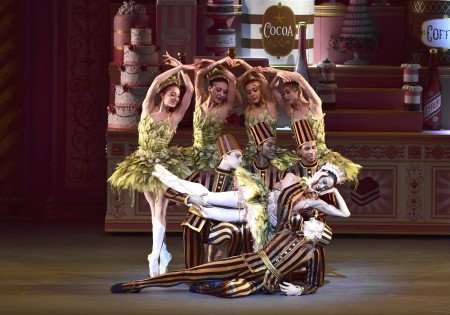 """Stella Abrera (reclining) and David Hallberg (on stage floor) and American Ballet Theatre dancers in Alexei Ratmansky's """"Whipped Cream"""" Photo by Gene Schiavone."""