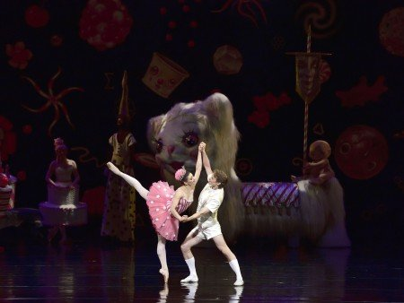 "Sarah Lane and Daniil Simkin, with Snow Yak and other characters (back) in Alexei Ratmansky's ""Whipped Cream"" Photo by Gene Schiavone."