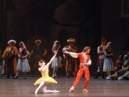 "American Ballet Theatre dancers Sarah Lane, Daniil Simkin, and members of the company in ""Le Corsaire"" Photo by mIRA."