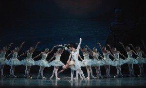"American Ballet Theatre dancers Devon Teuscher, Alexandre Hammoudi, and members of the company in ""Swan Lake"" Photo by Gene Schiavone"