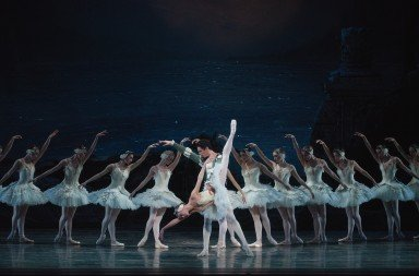 "American Ballet Theatre dancers  Devon Teuscher, Alexandre Hammoudi,  and members of the company  in ""Swan Lake""    Photo by Gene Schiavone"