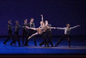 "Sterling Hyltin, Joaquin de Luz (right), and New York City Ballet dancers in Alexei Ratmansky's ""Odessa"" Photo by Paul Kolnik"