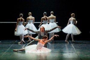 "Eifman Ballet dancers Maria Abashova, Oleg Markov, and members of the company in ""Red Giselle"" Photo by Yulia Kudryashova"