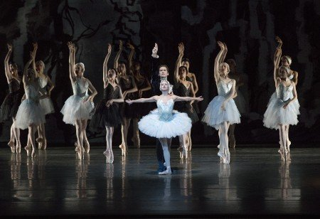"New York City Ballet dancers Sterling Hyltin and Zachary Catazaro and members of the company in Peter Martins's ""Swan Lake"" Photo by Paul Kolnik"