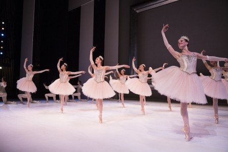 """Pacific Northwest Ballet dancer Leah Merchant (r) and members of the company in """"Diamonds"""" from George Balanchine's """"Jewels"""" Photo by Angela Sterling"""