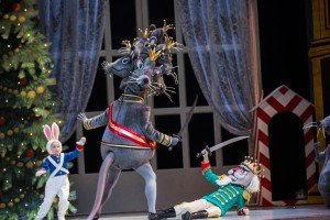 "Pacific Northwest Ballet dancer Joshua Grant (Mouse King) and PNB School students Tatiana Lipina (Hare Drummer) and Hugo Mestres (Nutcracker) in ""George Balanchine's 'The Nutcracker'"" Photo by Angela Sterling"
