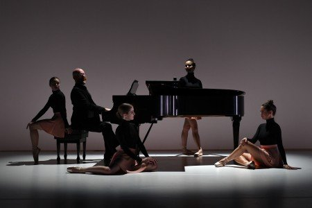"BalletNext dancers (l-r) Alice Regnouf, Emmie Strickland, Violetta Komyshan, and Egle Andreikaite [pianist Elliot Figg] in Michele Wiles's ""The Pianist"" Photo by Eduardo Patino"