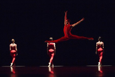 "Pacific Northwest Ballet dancer Jerome Tisserand with company dancers in Ulysses Dove's ""Red Angels"" Photo by Angela Sterling"