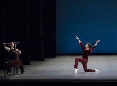 "Joaquin de Luz and Ann Kim (on cello) in Jerome Robbins's ""A Suite of Dances"" Photo by Paul Kolnik"