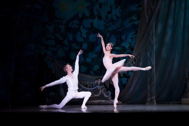 """Oregon Ballet Theatre dancer Xuan Chang, here with Chauncey Parsons, in OBT's production of """"George Balanchine's 'The Nutcracker'"""" Photo by James McGrew"""