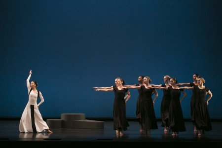 "Xin Ying (left) and members of Martha Graham Dance Company in ""Prelude to Action"" from ""Chronicle"" Photo by Melissa Sherwood"