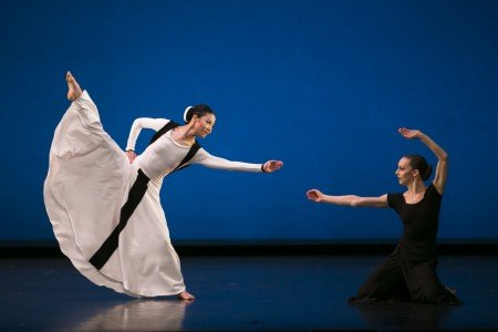 "Martha Graham Dance Company dancers Xin Ying and Anne Souder in ""Prelude to Action"" from ""Chronicle"" Photo by Melissa Sherwood-"